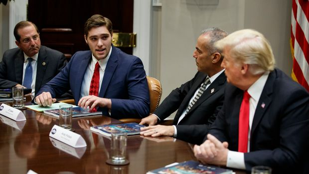 JT Lewis, brother of Sandy Hook victim Jesse Lewis, speaks to President Donald Trump during a roundtable discussion on the Federal Commission on School Safety report, in the Roosevelt Room of the White House, Tuesday, Dec. 18, 2018, in Washington. From left, Secretary of Health and Human Services Alex Azar, Lewis, Andy Pollack, father of Parkland victim Meadow Pollack, and Trump. (AP Photo/Evan Vucci)