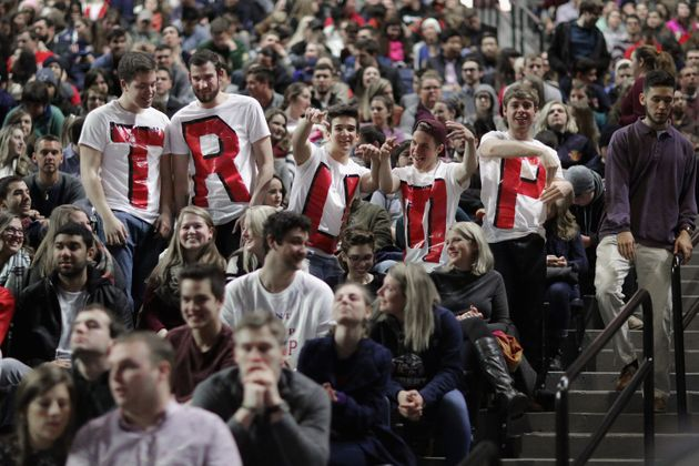 Liberty University students wear homemade T-shirts spelling