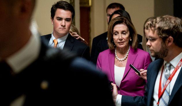 La présidente de la chambre des représentants, Nancy Pelosi, le 16 juillet avant le vote...