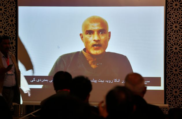 Pakistani journalists watch a video message of imprisoned Indian naval officer Kulbhushan Jadhav during...