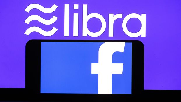 ANKARA, TURKEY - JULY 12: Screens of a smart phone and a laptop display the logos of Libra and Facebook in Ankara, Turkey on July 12, 2019. (Photo by Aytac Unal/Anadolu Agency/Getty Images)