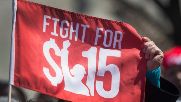 CHICAGO, IL - APRIL 14:  Demonstrators demanding an increase in the minimum wage march in the streets on April 14, 2016 in Chicago, Illinois. The demonstrators marched to and protested in front of several locations, part of a day-long effort to draw attention to low-wage jobs. The demonstration was one of about 300 scheduled to take place nationwide today.  (Photo by Scott Olson/Getty Images)