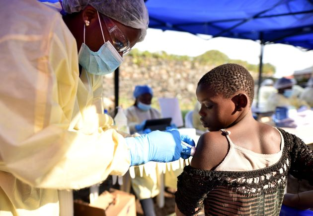 A Congolese health worker administers ebola vaccine to a child at the Himbi Health Centre in Goma, Democratic...