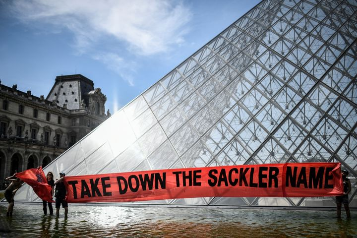 A protest outside the Louvre on July 1 condemned its ties with the Sackler family. The billionaire donors' highly addictive p