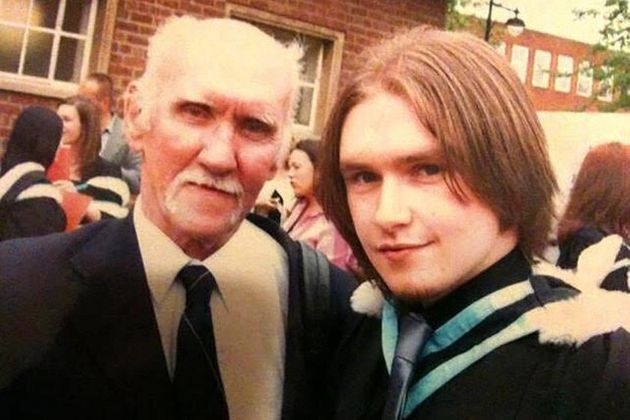 Sloan and his dad as Sloan receives his master's degree in