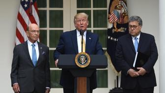 WASHINGTON, DC - JULY 11: U.S. President Donald Trump (C) speaks as U.S. commerce secretary Wilbur Ross (L) and U.S. attorney general William Barr (R) listen during a press conference about the 2020 census at the White House on July 11, 2019 in Washington, DC. (Photo by Chen Mengtong/China News Service/VCG via Getty Images)