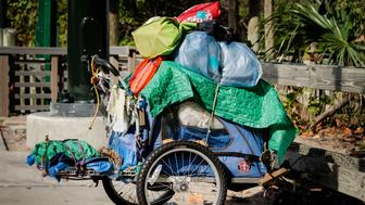 Boca Raton, FL, USA - February 16, 2013: A homeless person's belongings on a cart at a South Florida beach.