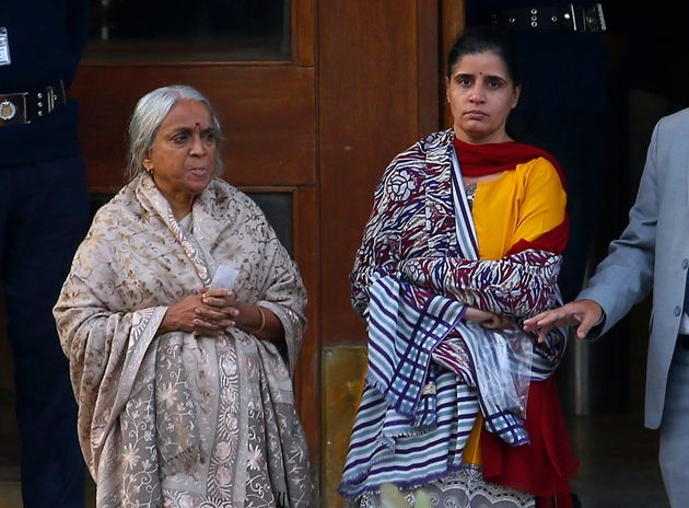 The wife, center, and mother, left, of imprisoned Indian naval officer Kulbhushan Jadhav, leave after...
