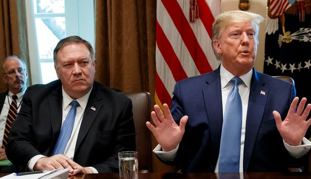 President Donald Trump speaks during a Cabinet meeting in the Cabinet Room of the White House, Tuesday, July 16, 2019, in Washington. Trump is accompanied by Secretary of State Mike Pompeo, left, and acting Defense Secretary Richard Spencer. (AP Photo/Alex Brandon)