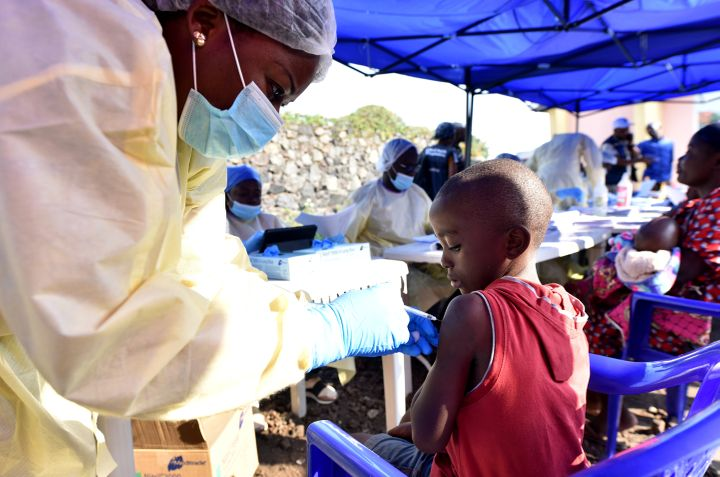 A Congolese health worker administers ebola vaccine to a child at the Himbi Health Centre in Goma, Democratic Republic of Con