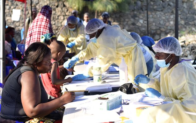 Congolese health workers collect data before administering ebola vaccines to civilians at the Himbi Health...