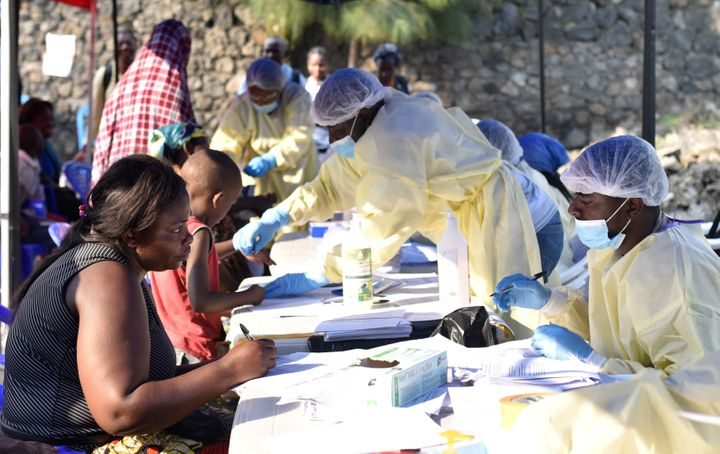 Congolese health workers collect data before administering ebola vaccines to civilians at the Himbi Health Centre in Goma, De