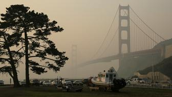FILE - In this Nov. 16, 2018, file photo, the Golden Gate Bridge is obscured by smoke and haze from wildfires in this view from Fort Baker near Sausalito, Calif. Tens of millions of people in the Western US face a growing health risk due to wildfires as more intense and frequent blazes churn out greater volumes of lung-damaging smoke, according to research scientists at NASA and several major universities. (AP Photo/Eric Risberg, File)