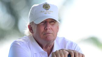 Mar 7, 2014; Miami, FL, USA; Donald Trump sits in a golf cart during the second round of the WGC - Cadillac Championship golf tournament at TPC Blue Monster at Trump National Doral. Mandatory Credit: Andrew Weber-USA TODAY Sports