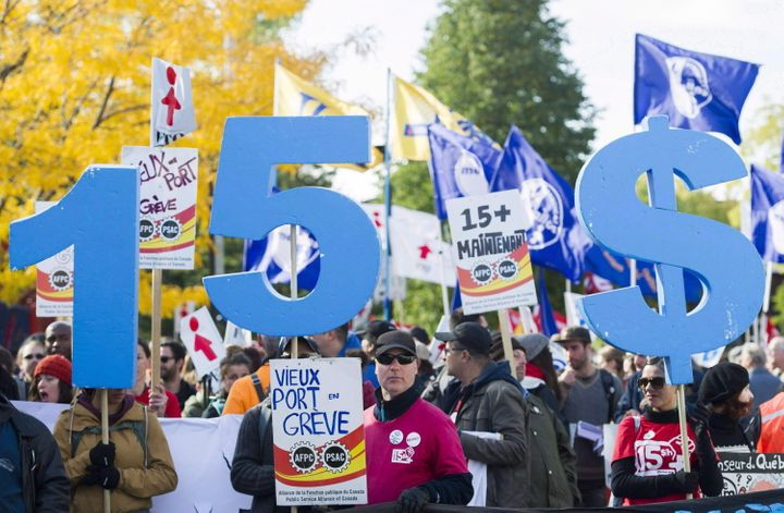 People gather in Montreal in 2016 to demand a $15 minimum wage.