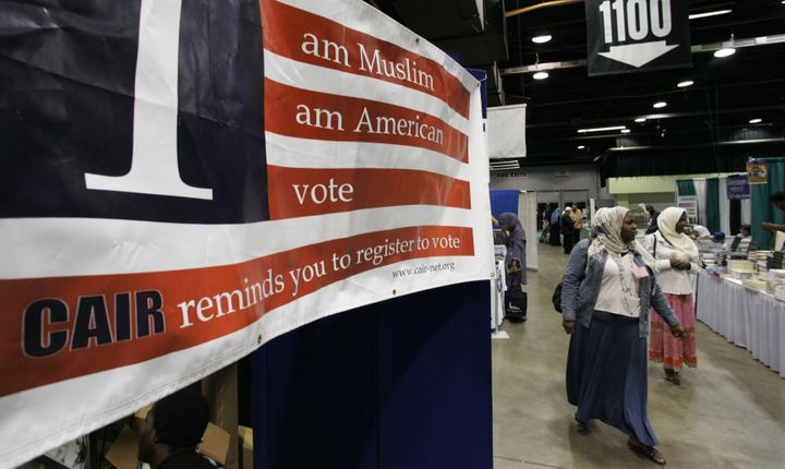 A sign at the 43rd annual Islamic Society of North America convention encourages participants to register to vote.