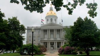 New Hampshire kicks off a weeklong bicentennial celebration for its Statehouse on Sunday, June 2, 2019, in Concord, with cake, building tours and reenactments of the first Legislative session. The granite building is the oldest state capitol in which both houses of the Legislature meet in their original chambers. (AP Photo/Holly Ramer)