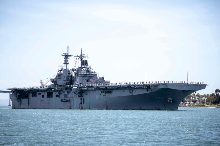 In this May 1, 2019, photo provided by the U.S. Navy, the amphibious assault ship USS Boxer transits the San Diego Bay in California. President Donald Trump says the USS Boxer destroyed an Iranian drone in the Strait of Hormuz amid heightened tensions between the two countries.