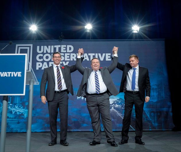 Jason Kenney, centre, celebrates his victory as the first official leader of the Alberta United Conservative...