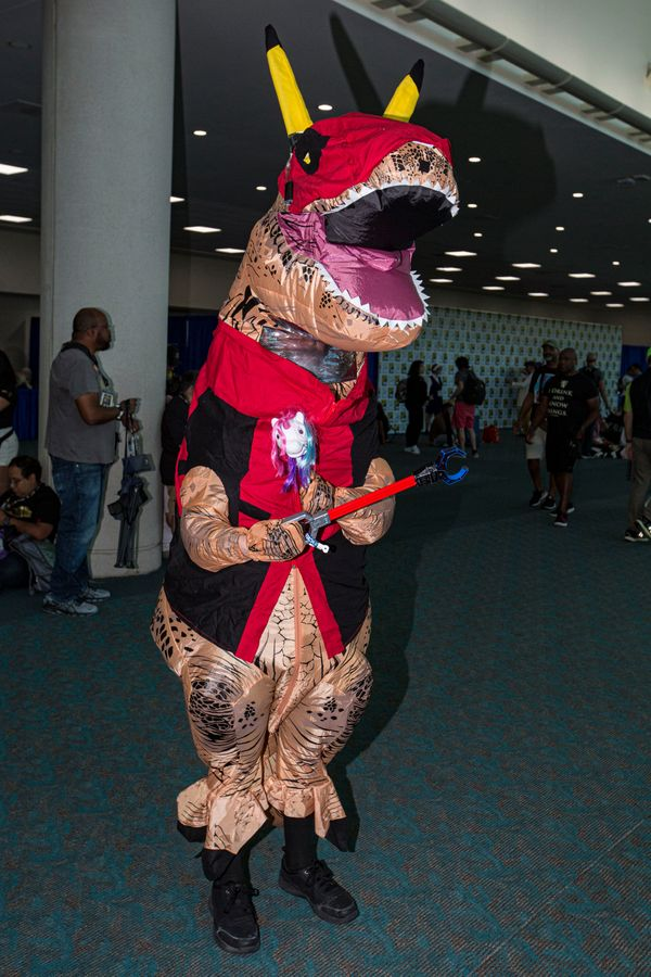 A cosplayer dressed as Tyrannosauras Deadpool.