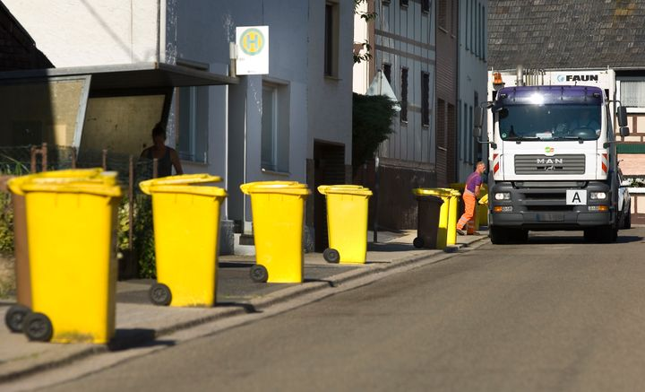 Yellow recycling bins, for packaging, plastic and metal, await collection.