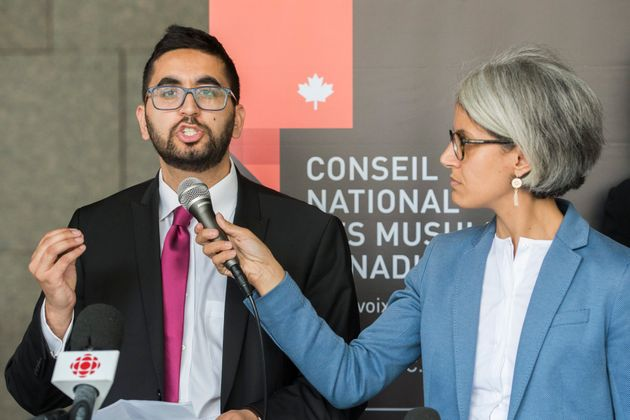 Members of the National Council of Canadian Muslims Mustafa Farooq, left, and Bochra Manai attend a news...