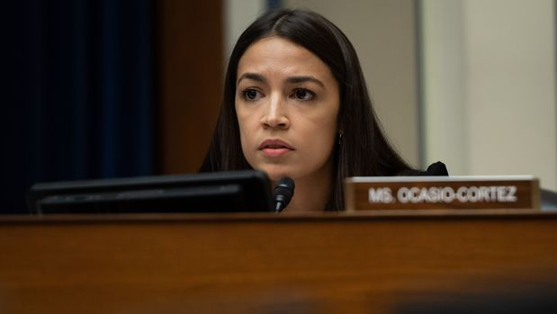 US Representative Alexandria Ocasio-Cortez, Democrat of New York, questions US Acting Secretary of Homeland Security Kevin McAleenan during a House Oversight and Reform Committee hearing on Capitol Hill in Washington, DC, July 18, 2019. (Photo by SAUL LOEB / AFP)        (Photo credit should read SAUL LOEB/AFP/Getty Images)