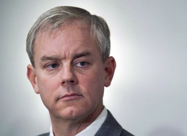Dennis Oland attends a news briefing by his legal team in Saint John, N.B., on Nov. 20,