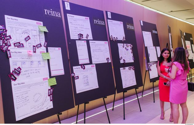 Attendees at the Reina Condos community consultation review the ideas board, July 11 in
