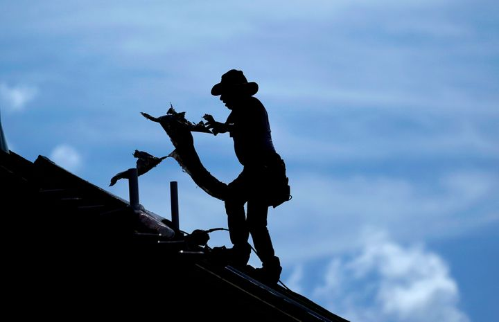A roofer works on a home under construction in Houston Thursday. A heat wave is expected to send temperatures soaring close t