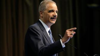 Former U.S. Attorney General Eric Holder, Jr. speaks during the National Action Network Convention in New York, Wednesday, April 3, 2019. (AP Photo/Seth Wenig)