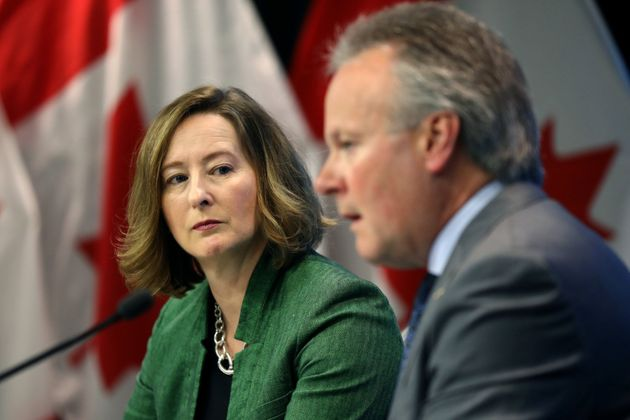 Bank of Canada senior deputy governor Carolyn Wilkins listens to governor Stephen Poloz speak at a news...