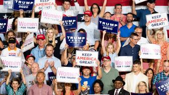 GREENVILLE, NC, UNITED STATES - 2019/07/17: Audience members hold placards during the  President Donald Trump's Make America Great Again Rally at the Williams Arena in East Carolina University, Greenville. (Photo by Michael Brochstein/SOPA Images/LightRocket via Getty Images)