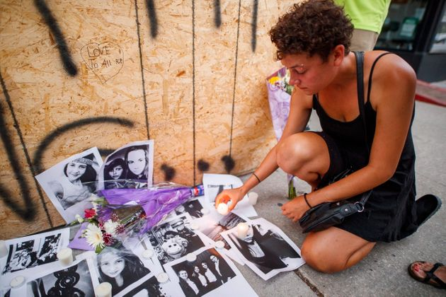 Desirae Shapiro, friend of shooting victim Reese Fallon, leaves a candle at a makeshift memorial on Danforth,...