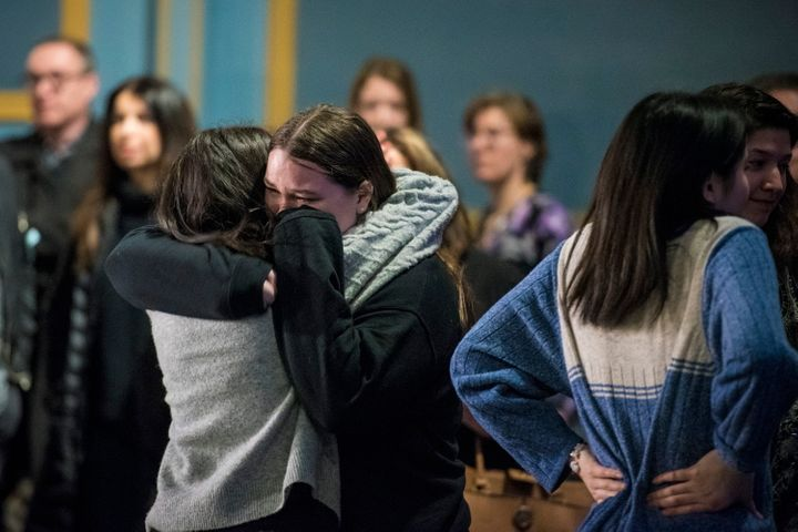 Survivors and loved ones affected by the shooting hug following their first public statement as a group at the Danforth Music Hall on Feb. 22, 2019.