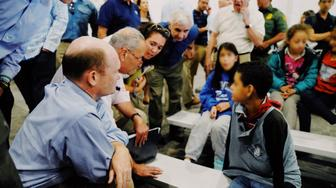 Chuck Schumer speaks to kids at a detention center in Texas