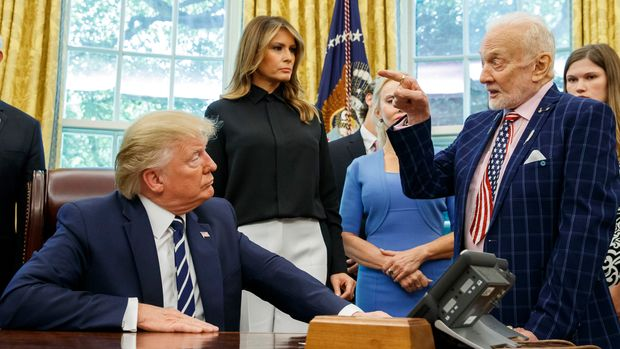President Donald Trump listens to Apollo 11 astronaut Buzz Aldrin, right, with Vice first lady Melania Trump, during a photo opportunity commemorating the 50th anniversary of the Apollo 11 moon landing in the Oval Office of the White House, Friday, July 19, 2019, in Washington. (AP Photo/Alex Brandon)