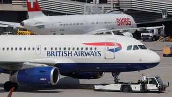 An aircraft of British Airways airlines is pulled by a Goldhofer pushback tractor of air service provider DNATA at Zurich airport, Switzerland April 16, 2019.  Picture taken April, 16, 2019.  REUTERS/Arnd Wiegmann