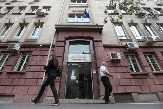 People walk outside Bulgaria's National Revenue Agency building in Sofia,