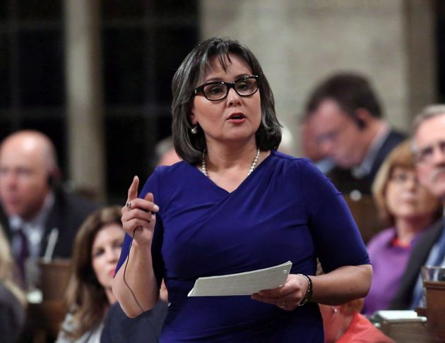 Leona Aglukkaq stands in the House of Commons during question period on June 9,