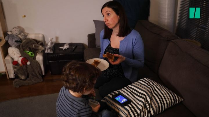 Natalie Stechyson and her son enjoy some quality screen time and bread.