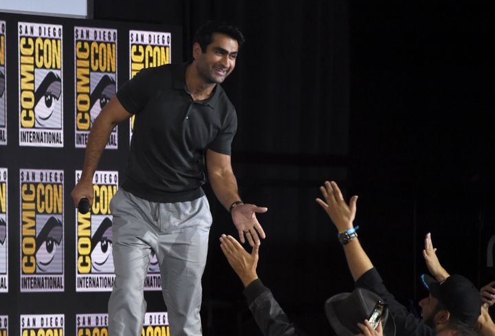 Kumail Nanjiani high-fiving fans on Saturday at San Diego Comic-Con.