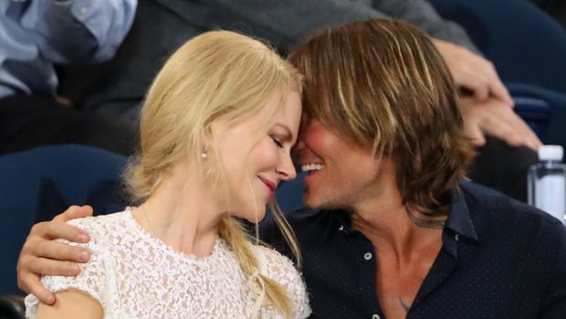 Tennis - Australian Open - Semi-final - Melbourne Park, Melbourne, Australia, January 24, 2019. Keith Urban embraces Nicole Kidman. REUTERS/Lucy Nicholson