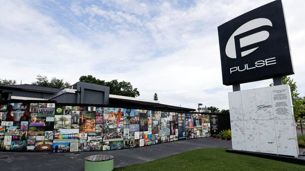 An outside view of the Pulse nightclub is seen before a news conference to introduce legislation that would designate the Pulse nightclub site as a national memorial, Monday, June 10, 2019, in Orlando, Fla. (AP Photo/John Raoux)