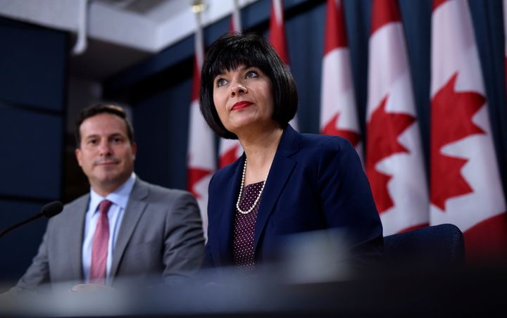 Health Minister Ginette Petitpas Taylor and Liberal MP Marco Mendicino, left, speak at a press conferenceat the National Press Theatre in Ottawa on July 22, 2019.