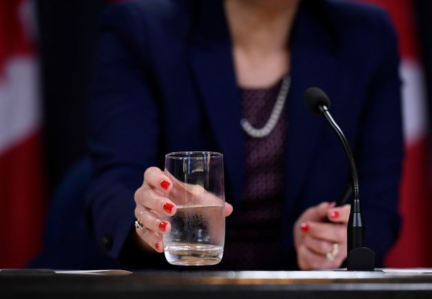 Health Minister Ginette Petitpas Taylor drinks from a glass of water during a press conference at the...