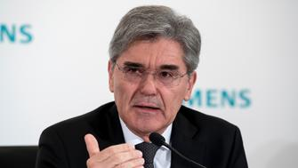 Siemens CEO Joe Kaeser speaks during the annual press conference of the German industrial giant in Munich, southern Germany, Wednesday, Jan. 31, 2018. (Sven Hoppe/dpa via AP)