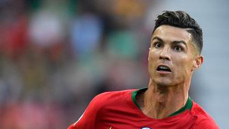 Portugal's Cristiano Ronaldo eyes the ball during the UEFA Nations League final soccer match between Portugal and Netherlands at the Dragao stadium in Porto, Portugal, Sunday, June 9, 2019. (AP Photo/Martin Meissner)