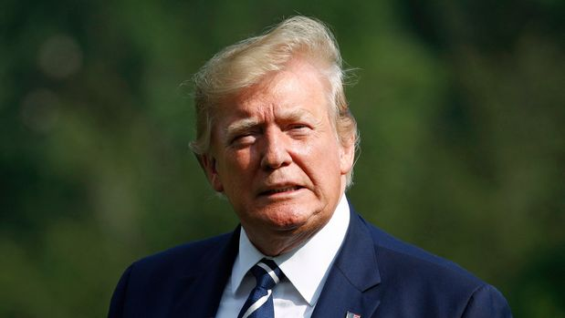 President Donald Trump arrives at the White House in Washington, Sunday, July 21, 2019, after spending the weekend at his golf club in Bedminster, N.J. (AP Photo/Patrick Semansky)