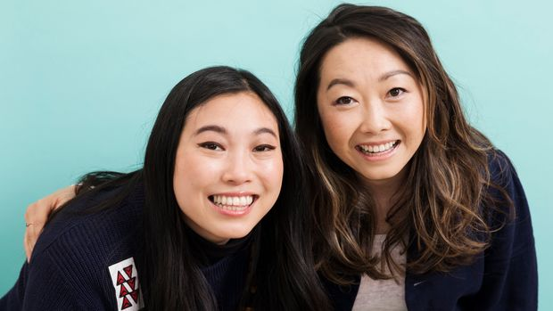 "This June 12, 2019 photo shows filmmaker Lulu Wang, right, and actress Awkwafina posing in New York to promote their film, ""The Farewell."" (Photo by Brian Ach/Invision/AP)"